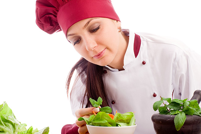 photo of succesfull female restaurant chef on white background